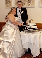 Zoe and Ian with wedding cake