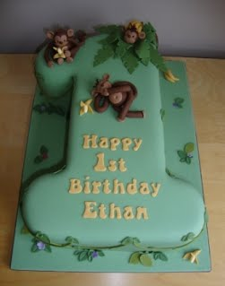 A Chocolate Fudge Cake Carved Into Number 1 Shape And Decorated With Cheeky Monkeys Stealing Bananas From The Palm Tree Surrounded By Leafy Vines